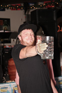 Man holding up beer mug
