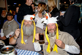 Two men with chicken hats