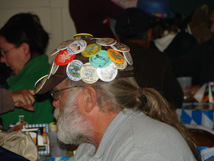Man with buttons on hat